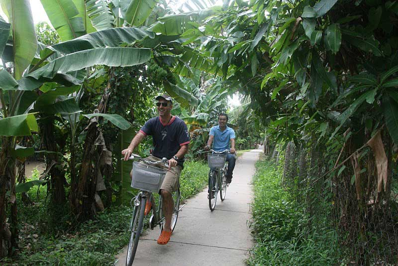 Exploring the Mekong delta by bicycle and cruise vessel